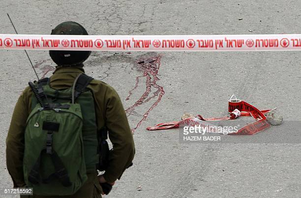 Graphic content / Blood stains from the body of a Palestinian assailant who was allegedly shot in the head by an Israeli soldier as he lay wounded on...