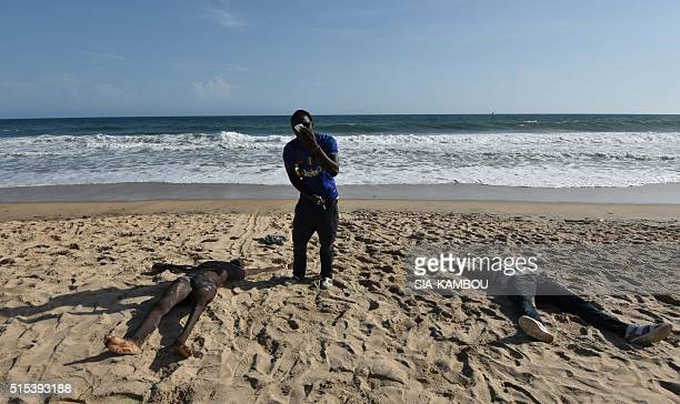 Graphic content / Bodies are seen on a beach after heavily armed gunmen opened fire on March 13 2016 at a hotel in the Ivory Coast beach resort of...