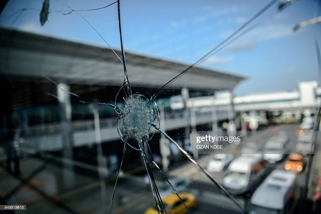 Bullet impacts are pictured on a window at Ataturk airport's International airport on June 29, 2016, a day after a suicide bombing and gun attack targeted Istanbul's airport, killing at least 36 people. A triple suicide bombing and gun attack that occurred on June 28, 2016 at Istanbul's Ataturk airport has killed at least 36 people, including foreigners, with Turkey's prime minister saying early signs pointed to an assault by the Islamic State group. / AFP / OZAN