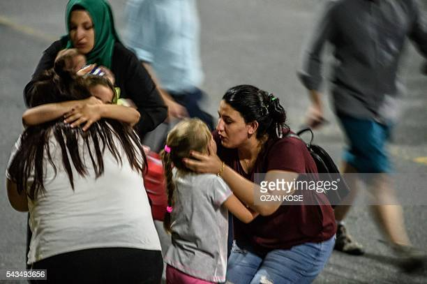 Graphic content / Children and their relatives embrace as they leave Ataturk airport on June 28 2016 in Istanbul after two explosions followed by...