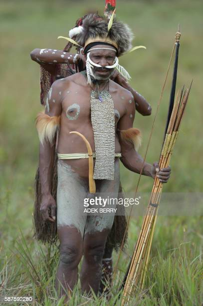 Graphic content / Dani tribe people participate in the 27th annual Baliem Valley Festival in Walesi district in Wamena Papua Province on August 9...