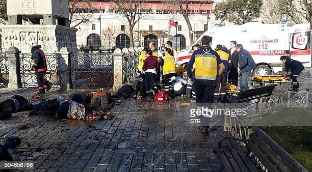 Graphic content / Emergency responders work beside victims at the site of a blast in Istanbul's Sultanahmet district the city's main tourist hub on...