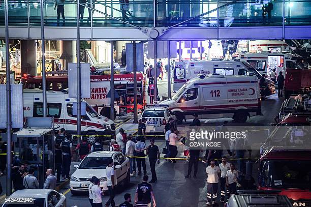 Graphic content / Forensic police work the explosion site at Ataturk airport on June 28 2016 in Istanbul after two explosions followed by gunfire hit...