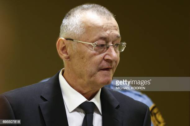 Graphic content / Former Serbian intelligence chief Franko Simatovic appears in court as he goes back on trial before a UN court in The Hague on June...
