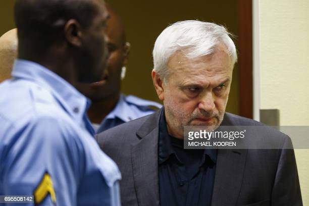 Graphic content / Former Serbian intelligence chief Jovica Stanisic appears in court as he goes back on trial before a UN court in The Hague on June...