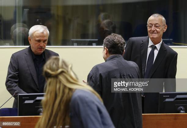 Graphic content / Former Serbian intelligence chiefs Jovica Stanisic and Franko Simatovic appear in court as they go back on trial before a UN court...
