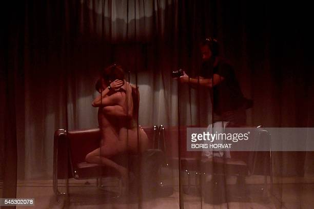 Graphic content / French actors Antoine Ferron and Noemie Gantier from the collective 'Si vous pouviez lecher mon coeur' perform during the rehearsal...