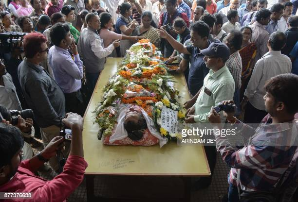 Graphic content / Indian journalists stand near the body of crime reporter Sudip Datta Bhowmik at his funeral in Agartala the capital of northeastern...
