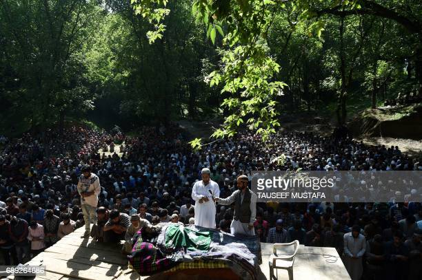 Graphic content / Indian Kashmiri villagers offer funeral prayers by the body of rebel commander Sabzar Ahmad Bhat in Rathsuna Tral near Srinagar on...
