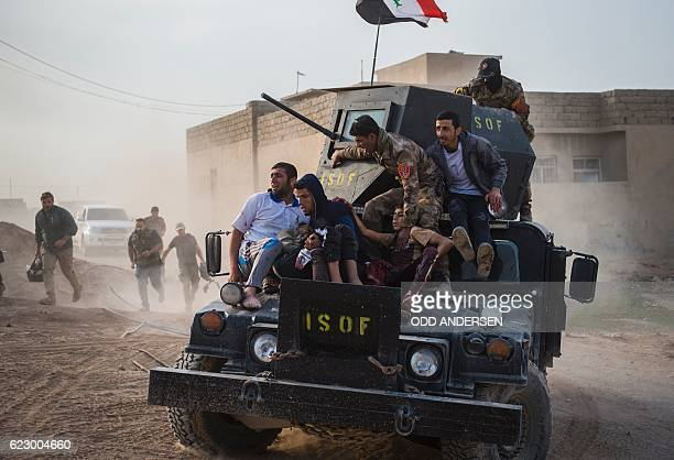 Graphic content / Iraqi soldiers and family rush 12yearold Mohammed and 15yearold Shafiq to an outdoor field clinic on their Humvee in the Samah...