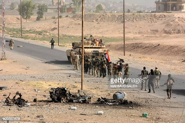 Graphic content / Iraqi troops deploy in the town of Sharqat 260 kilometres northwest of Baghdad and around 80 kilometres south of Mosul on September...