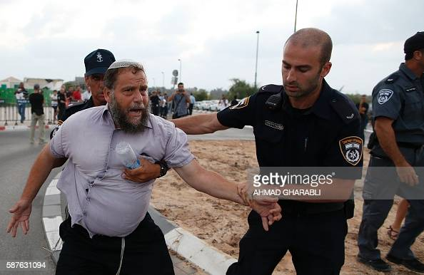 Graphic content / Israeli police detain an Israeli man demonstrating in opposition to Palestinians protesting against administrative detention and in...