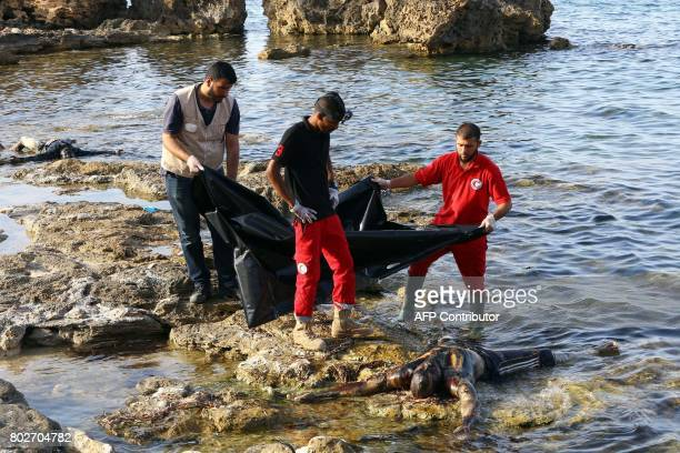 Graphic content / Members of Libya's Red Crescent recover the body of a migrant that washed ashore in Tajura a coastal suburb of the Libyan capital...
