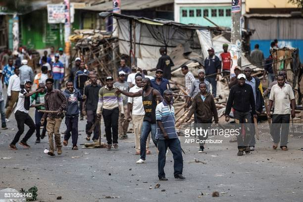 Graphic content / Members of the Kikuyu ethnic group stand with sticks pangas and stones during a street battle between residents of the Mathare slum...