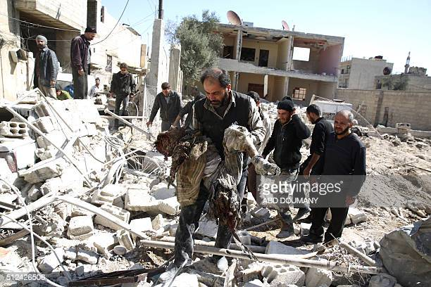 Graphic content / Members of the Syrian Arab Red Crescent and residents search through the rubble for bodies following an airstrike in the rebelheld...