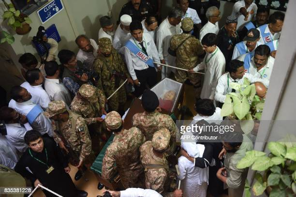 Graphic content / Pakistani Army personnel and others gather around the coffin of Ruth Pfau a German nun who devoted her life to combatting leprosy...