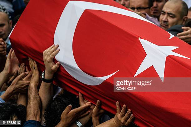 Graphic content / People carry a coffin covered with Turkish national flag of Hamidullah Safar on June 30 2016 during his funeral two days after he...