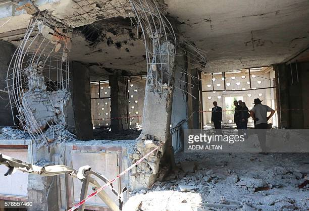 Graphic content / People inspect damage after the Grand National Assembly of Turkey was bombed by rebel jets on July 16 2016 in Ankara July 15 putsch...