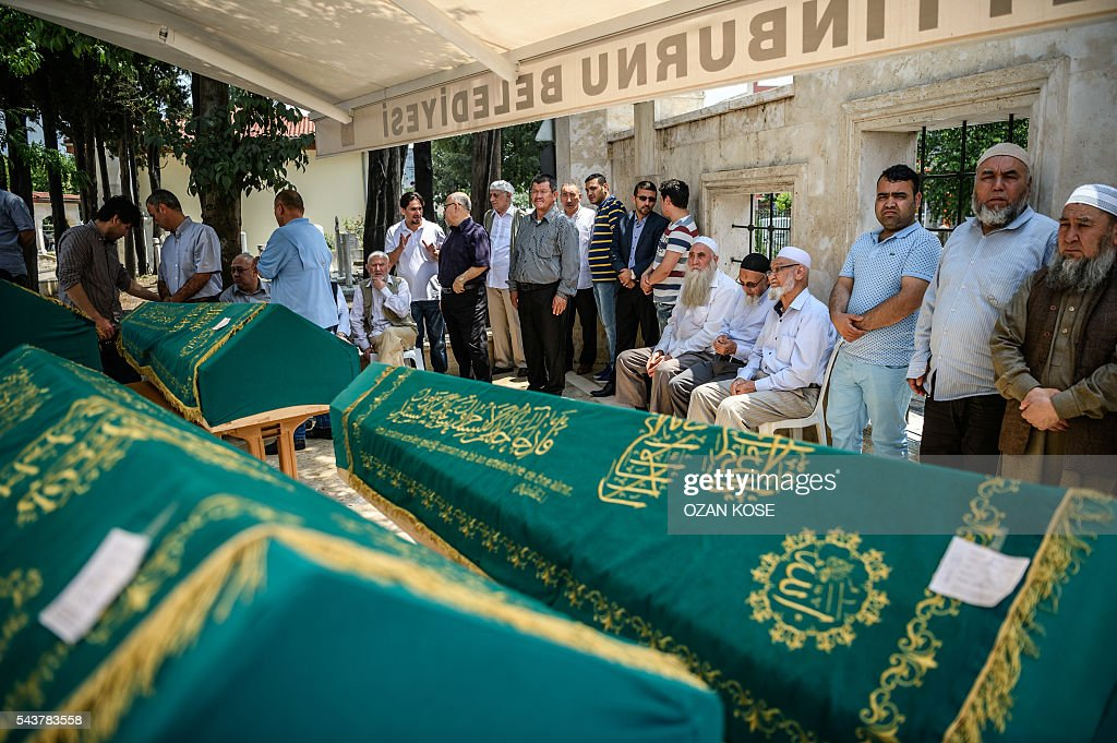 People mourn next to coffins of Maryam Amiri, Karime Amiri, Zahra Amiri and Huda Amiri on June 30, 2016 in Istanbul during their funeral two days after they were killed by a suicide bombing and gun attack targeted Istanbul's airport, killing at least 36 people. The death toll from the triple suicide bombing and gun attack that occurred on June 28, 2016 at Istanbul's Ataturk airport has risen to 43 including 19 foreigners. The government has pointed the finger of blame at the Islamic State group and Turkish police rounded up 13 suspected IS jihadists in raids at 16 different locations across Istanbul on June 30. KOSE