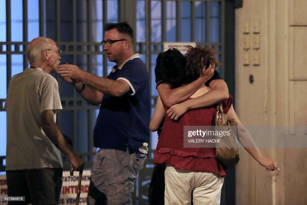 Graphic content / People react in the French Riviera town of Nice on July 15 after a van drove into a crowd watching a fireworks display At least 60...