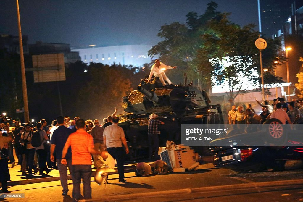 Graphic content / People take streets in Ankara Turkey during a protest against military coup on July 16 2016 42 dead in Ankara coup attempt clashes...