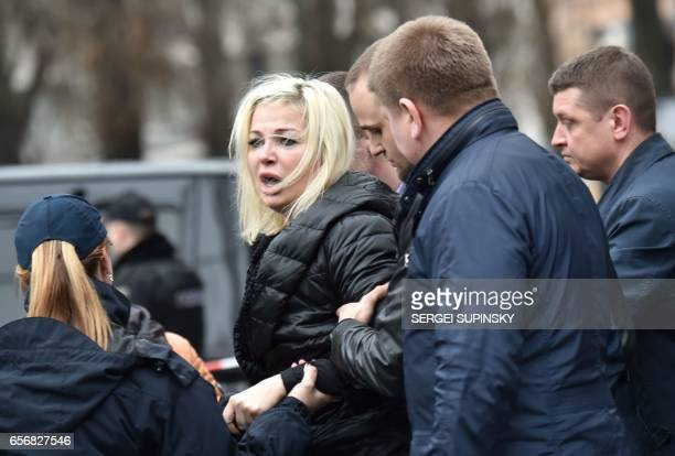 TOPSHOT Policemen hold Maria Maksakova wife of Denis Voronenkov as she reacts near his body in the center of Kiev on March 23 2017 Former Russian MP...