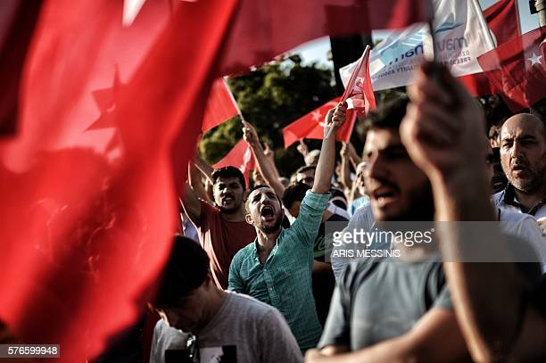 Graphic content / ProErdogan protesters wave Turkish flags and shout slogans as they demonstrate in Istanbul in support the government on July 16...