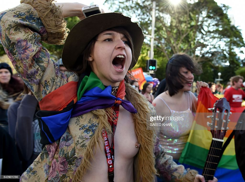 Graphic content / Pro-gay marriage supporters shout slogans calling for more rights during a rally in Sydney on June 25, 2016. Hundreds of supporters of gay marriage marched through the streets of the central business district of Sydney for their rights. / AFP / SAEED
