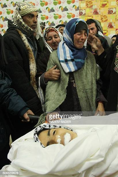 Graphic content / Raida the mother of Roqaya AbuEid a Palestinian teenager who was shot dead following a stabbing attack mourns next to her...