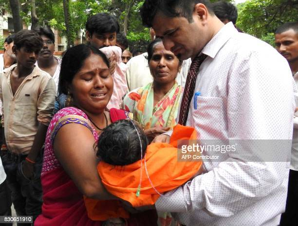 Graphic content / Relatives mourn the death of a child at the Baba Raghav Das Hospital in Gorakhpur in the northern Indian state of Uttar Pradesh on...
