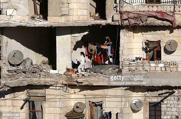 Graphic content / Residents in a governmentheld part of Aleppo's Salaheddin neighbourhood watch as buses evacuate rebel fighters and their families...