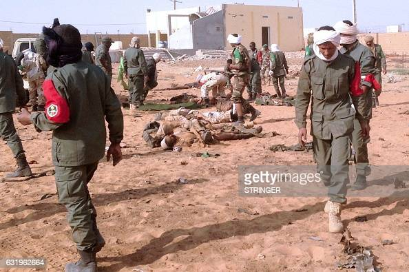 Graphic content / Soldiers attend to wounded and casualties in the aftermath of a suicide bomb attack who ripped through a camp grouping former...