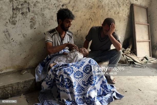 Graphic content / Syrians mourn over the body of baby following bombardment on the alMarja neighbourhood of the northern Syrian city of Aleppo on...