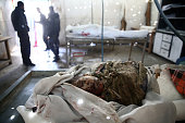 Graphic content / The body of a boy is is pictured inside a makeshift hospital following an airstrike in the rebelheld city of Douma in Eastern...