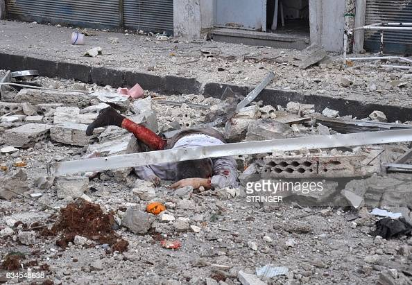 Graphic content / The body of a man lies amidst debris following a reported mortar strike by rebel fighters in a governmentheld part of the Syrian...
