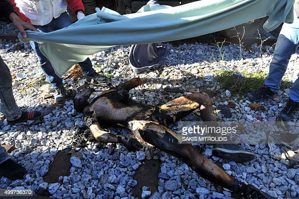 Graphic content / The body of a migrant who died of electrocution on December 3 2015 after clashes broke out between refugees and migrants trapped on...
