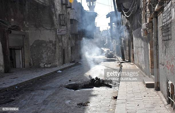 Graphic content / The charred body of a rebel fighter lies on a street in the Bab alHadid neighbourhood in Aleppo's Old City on December 8 after...