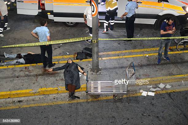 Graphic content / This picture obtained from the Ihlas News Agency shows ambulances and police intervening next to injured people lying on the ground...