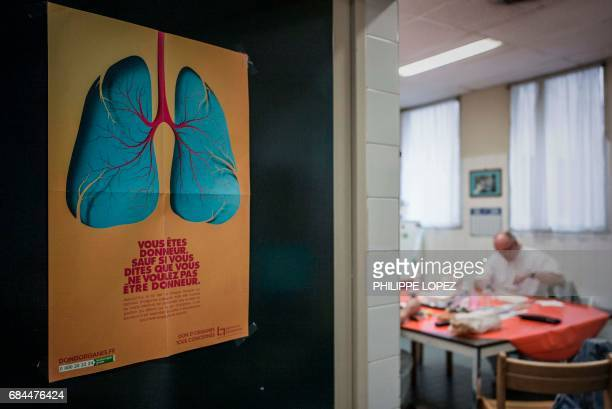 Graphic content / This picture taken on May 11 2017 shows an employee having lunch in a room at the morgue of the Hospital Bichat Claude Bernard in...