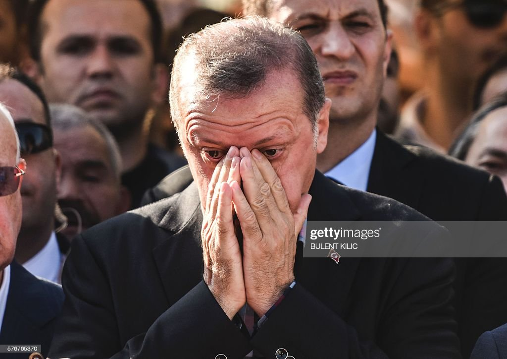 Graphic content / Turkey's President Recep Tayyip Erdogan reacts after attending the funeral of a victim of the coup attempt in Istanbul on July 17...