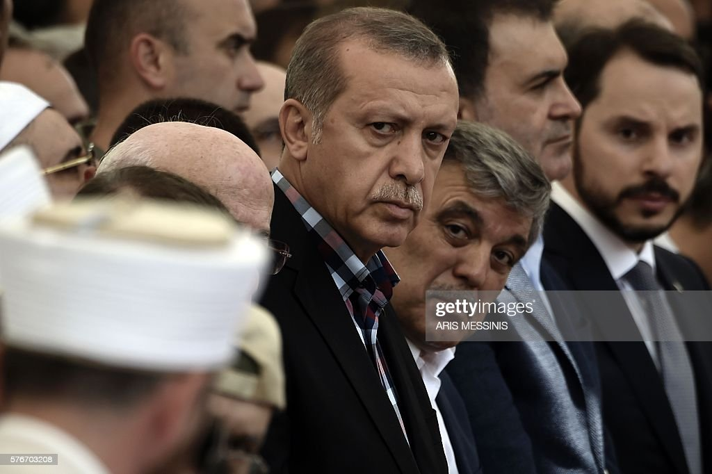 Graphic content / Turkish President Recep Tayyip Erdogan and former Turkish president Abdullah Gul attend the funeral of a victim of the coup attempt...
