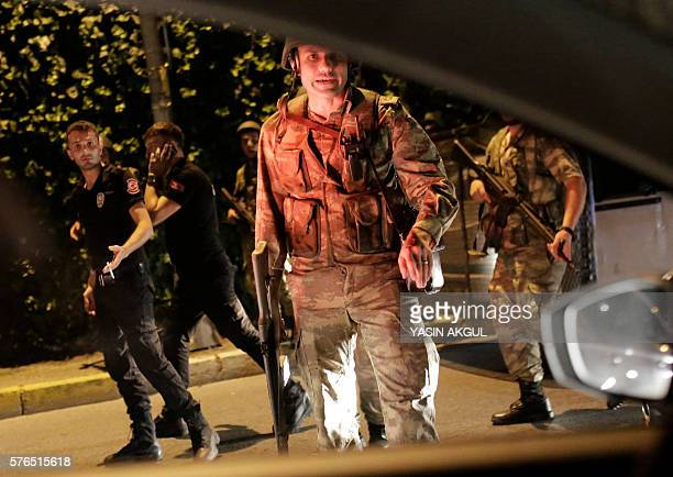 Graphic content / Turkish security officers detain Turkish police officers on July 15 2016 in Istanbul during a security shutdown of the Bosphorus...