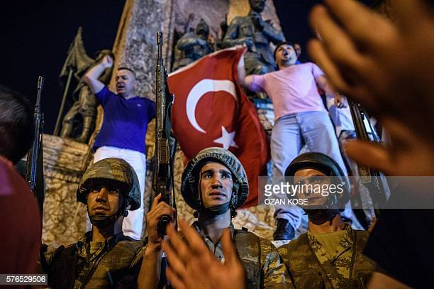 Graphic content / Turkish solders stay at Taksim square as people react in Istanbul on July 16 2016 Turkish military forces on July 16 opened fire on...