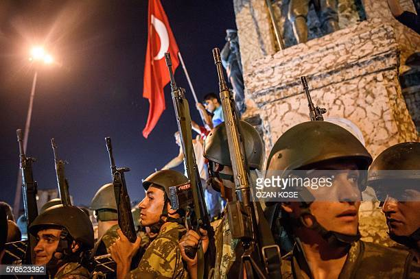 Graphic content / Turkish solders stay at Taksim square as people protest against the military coup in Istanbul on July 16 2016 Turkish military...