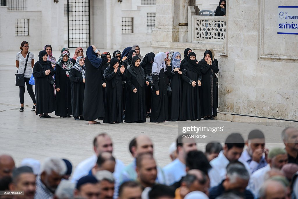 Women pray during the funerals of Maryam Amiri, Karime Amiri, Zahra Amiri and Huda Amiri on June 30, 2016 two days after they were killed by a suicide bombing and gun attack targeted Istanbul's Ataturk airport, killing 42 people. The death toll from the triple suicide bombing and gun attack that occurred on June 28, 2016 at Istanbul's Ataturk airport has risen to 43 including 19 foreigners. The government has pointed the finger of blame at the Islamic State group and Turkish police rounded up 13 suspected IS jihadists in raids at 16 different locations across Istanbul on June 30. KOSE