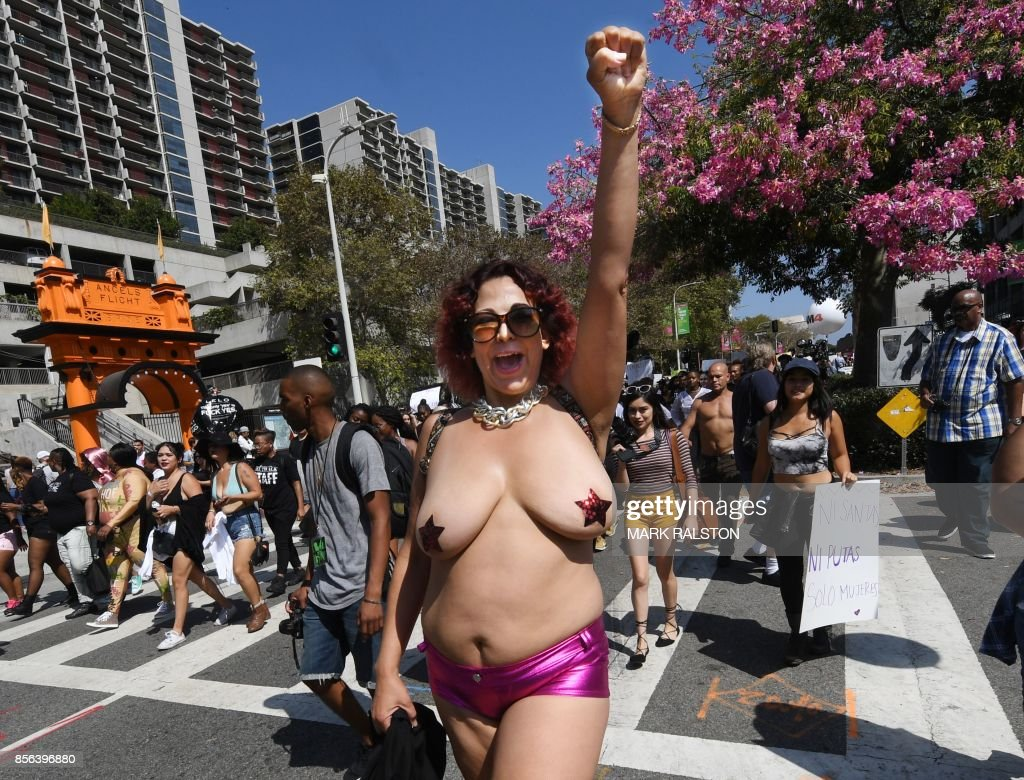 Graphic content / Women's rights activists march against gender inequalities during what the organizers called 'the third annual Amber Rose SlutWalk' in downtown Los Angeles, California on October 1, 2017. The march was organized by the Amber Rose Foundation to support gender equality and end rape, victim blaming, and body-shaming. / AFP PHOTO / Mark RALSTON