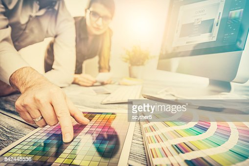 Graphic designer at work. Color samples. : Stock Photo