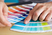Graphic designer choosing a color from the palette