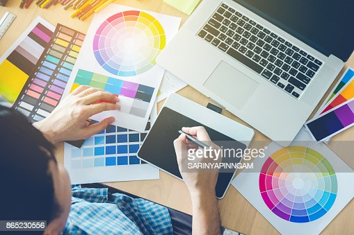 Graphic designer drawing on graphics tablet at workplace : Stock Photo