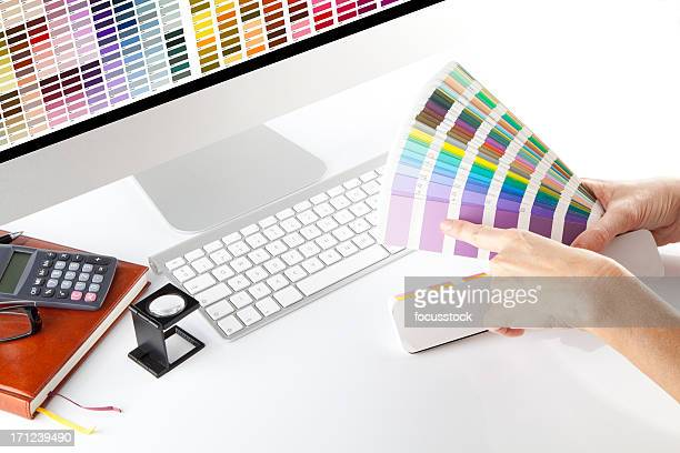 Graphic designer looking through color samples